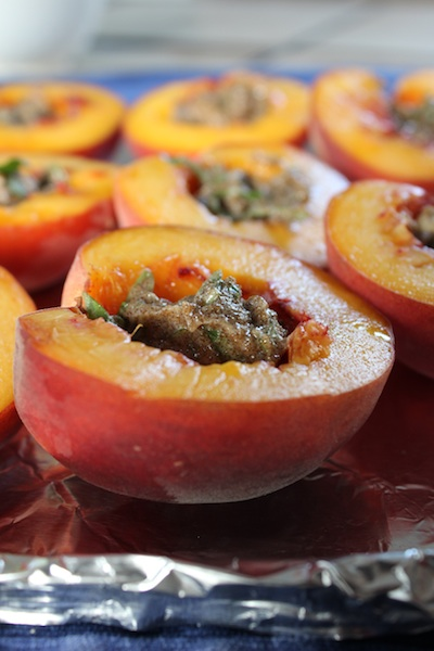 Halved peach filled with softened butter, brown sugar, cinnamon, salt, and basil