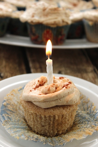 These Snickerdoodle Cupcakes with Brown Sugar Cinnamon Frosting are light and tender with a hint of warmth. This cooked icing is barely sweetened, meaning these are perfect for a birthday party or just with a cup of afternoon tea.| www.tastyoasis.net