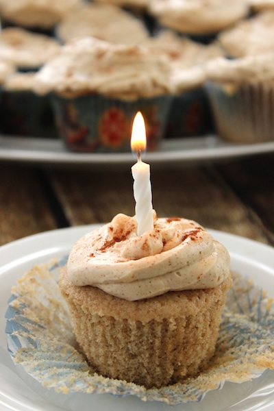These Snickerdoodle Cupcakes with Brown Sugar Cinnamon Frosting are light and tender with a hint of warmth. This cooked icing is barely sweetened, meaning these are perfect for a birthday party or just with a cup of afternoon tea. | www.tastyoasis.net