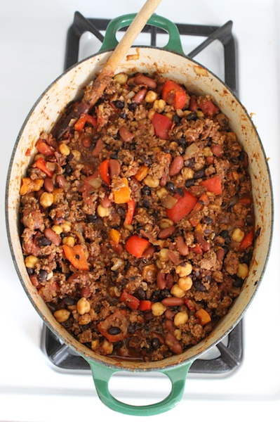 "This Three Bean Turkey Chili is healthy and a hearty dish on a cold night. With layers of flavor, the mix of smoked paprika, chipotle, cinnamon and even a touch of chocolate warms you with every bite. This recipe is ""big batch cooking,"" so you can serve a crowd or pack portions away in the freezer for future meals, making life easier down the road. It's comfort food that you can feel good about. 