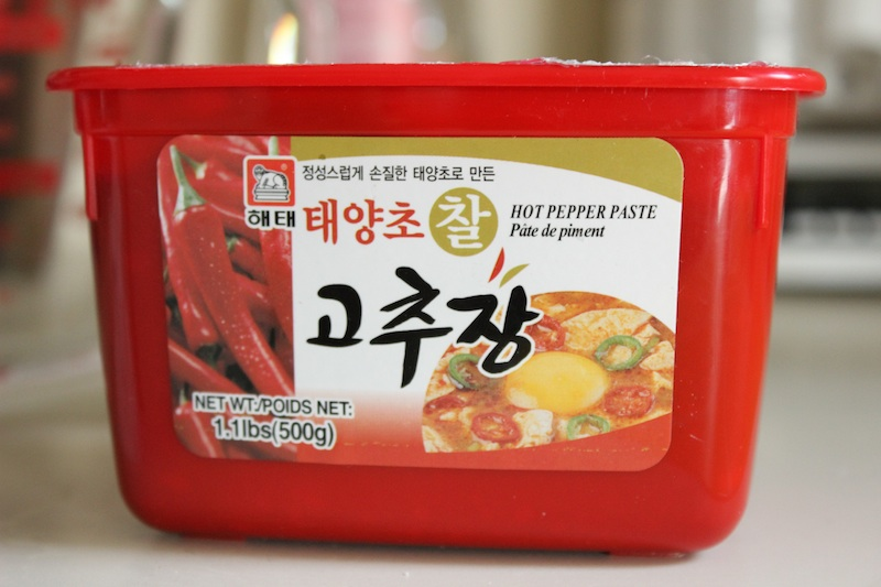 Korean Chili Paste: Gochujang. This Korean Chili Honey Sauce is sweet and spicy, and fast and easy to make. Perfect on grilled chicken, you only need 3 ingredients and you can have dinner on the table in less than 20 minutes. Gochujang, the red pepper and soybean paste that is the basis for the sauce, transforms any meal, and is just as good on meat as it is on a vegan dish. | www.tastyoasis.net