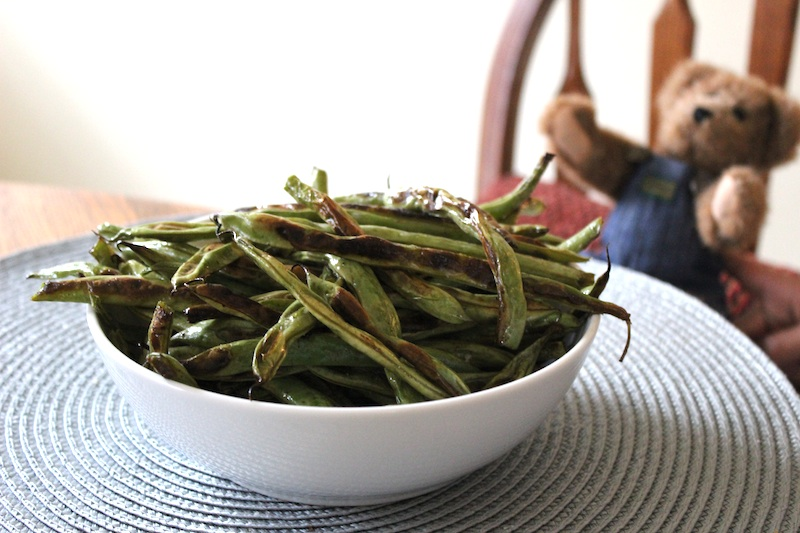 Roasting green beans is fast and easy, and a healthy way to get vegetables on the table with little mess. They taste amazing, and the blistered spots add a sweet flavor that is perfectly balanced with just simple salt and pepper.| www.tastyoasis.net