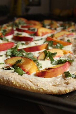 This Peach, Ricotta and Basil Pizza tastes like summer. At once creamy, sweet and salty, every bite is balanced, so this quick and easy dish is perfect on its own, or served as an appetizer for company. | www.tastyoasis.net