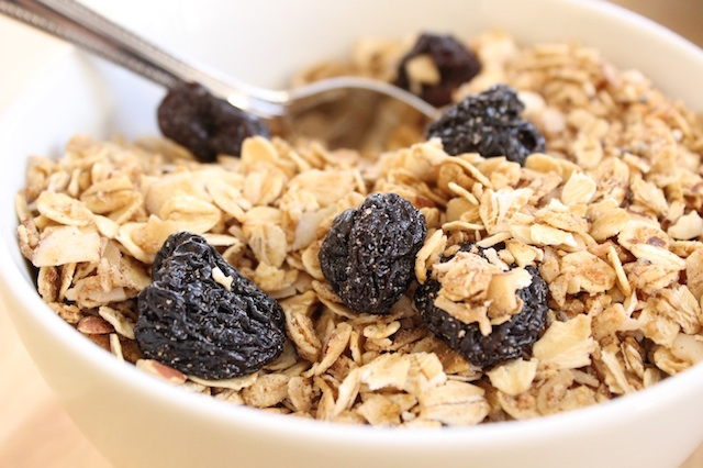 This Coconut Maple Granola is flexible, fast and easy to make, and healthy. Only lightly sweetened, it's crunchy with a hint of salt, extra flavor from cinnamon, ginger and maple, and has toasted coconut laced throughout it. Perfect for a quick breakfast or snack, it's something you can feel good about baking and eating.| www.tastyoasis.net